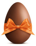 Chocolate Easter Egg with ribbon Bow isolated on white ba Stock Photos