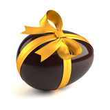 Chocolate easter egg with yellow ribbon. Isolated on white background Stock Images