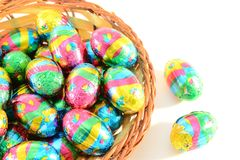 Chocolate easter eggs. In a wicker basket Stock Images