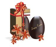 Chocolate Easter eggs. With box and orchid flowers on white background Stock Photos