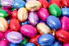 Chocolate easter eggs. A lot of chocolate easter eggs in closeup royalty free stock photo