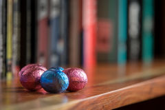 Chocolate Easter Eggs on bookcase Royalty Free Stock Images