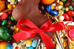 Chocolate Easter eggs and chocolate bunny and colorful sweets. royalty free stock images