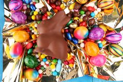 Chocolate Easter eggs and chocolate bunny and colorful sweets. royalty free stock image