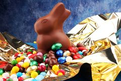 Chocolate Easter eggs and chocolate bunny and colorful sweets. royalty free stock photo