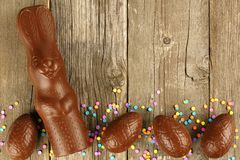 Chocolate Easter eggs and bunny on wood Royalty Free Stock Photo