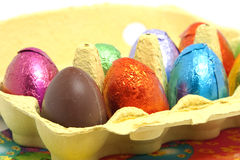 Chocolate easter eggs in carton box. Closeup of colorful chocolate easter eggs in carton box Stock Images