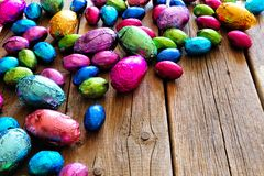 Chocolate Easter Eggs corner border against rustic wood Royalty Free Stock Photography