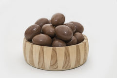 Chocolate easter eggs  in a crafted wooden bowl Stock Photo