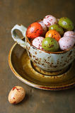 Chocolate easter eggs in a cup Stock Photo