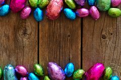 Chocolate Easter Eggs double border against rustic wood Stock Photo