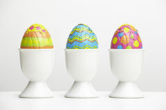 Chocolate easter eggs in egg cups Stock Images