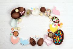 Chocolate Easter eggs figurine Easter bunny on a wooden background stock photography