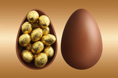 Chocolate Easter eggs on gold background Royalty Free Stock Image