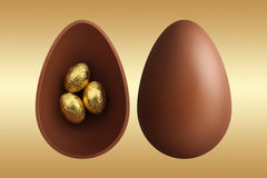 Chocolate Easter eggs on gold background Royalty Free Stock Photography