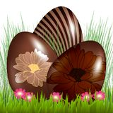 Chocolate easter eggs on grass.  royalty free illustration
