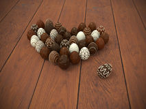 Chocolate Easter eggs heart on brown wooden floor. Photorealistic chocolate Easter eggs heart on brown wooden floor - hi-res 3d rendered picture with vignette Royalty Free Stock Image