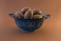 Chocolate Easter eggs in a Moroccan blue decorated bowl Royalty Free Stock Photo