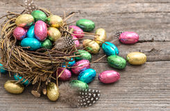 Chocolate easter eggs in nest. Festive still life Stock Photography