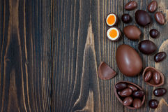 Chocolate Easter eggs over rustic wooden background. Copy space. royalty free stock photos