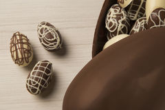 Chocolate Easter Eggs Over Wooden Background. Royalty Free Stock Photos