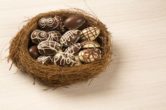 Chocolate Easter Eggs Over Wooden Background. Royalty Free Stock Image