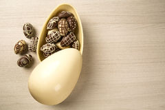 Chocolate Easter Eggs Over Wooden Background. Stock Photos