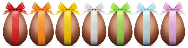 Chocolate easter eggs with ribbon Bow on white backgrou Royalty Free Stock Images