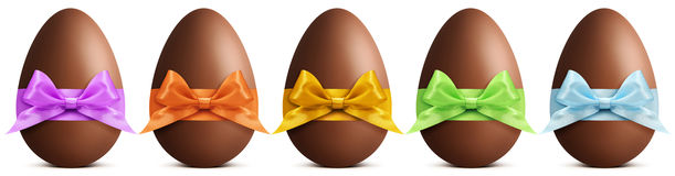Chocolate easter eggs with ribbon Bow on white background Royalty Free Stock Images