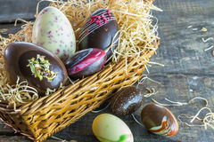 Chocolate easter eggs. On rustic wooden background Royalty Free Stock Image