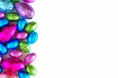 Chocolate Easter Eggs side border over white Royalty Free Stock Image