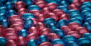 Chocolate easter eggs surrounding one standing egg Royalty Free Stock Photos