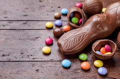 Chocolate easter eggs and sweets on wooden background Royalty Free Stock Photography