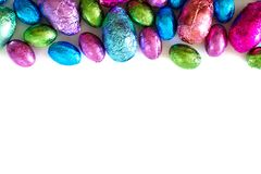 Chocolate Easter Eggs top border over white Royalty Free Stock Images