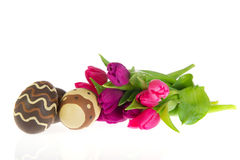Chocolate easter eggs with tulips Royalty Free Stock Image
