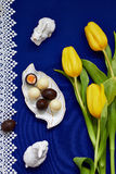 Chocolate easter eggs. And tulips Stock Photography