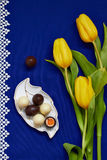 Chocolate easter eggs. And tulips Stock Photos