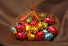 Chocolate easter eggs on velvet background Royalty Free Stock Photo