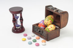 Chocolate Easter eggs in a wooden coffin Stock Photos