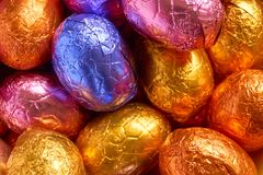 Chocolate easter eggs wrapped in foil Stock Photos