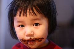 Chocolate eater Stock Photography