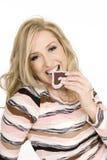 chocolate eating woman Στοκ Εικόνες