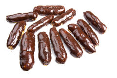 Chocolate eclair close up on white Royalty Free Stock Images