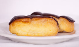 Chocolate Eclair. On a plate Stock Image