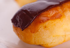 Chocolate Eclair. On a plate Stock Photo