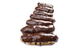 Chocolate eclair on white macro Stock Images