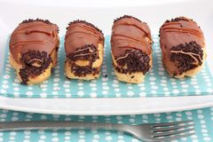 Chocolate eclairs Stock Photos