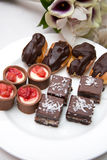 Chocolate eclairs and brownies Stock Image