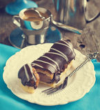 Chocolate eclairs and cup of espresso. Royalty Free Stock Images