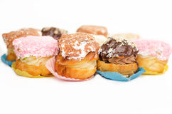 Chocolate eclairs- Krapfen or donuts with isolated White background Royalty Free Stock Image